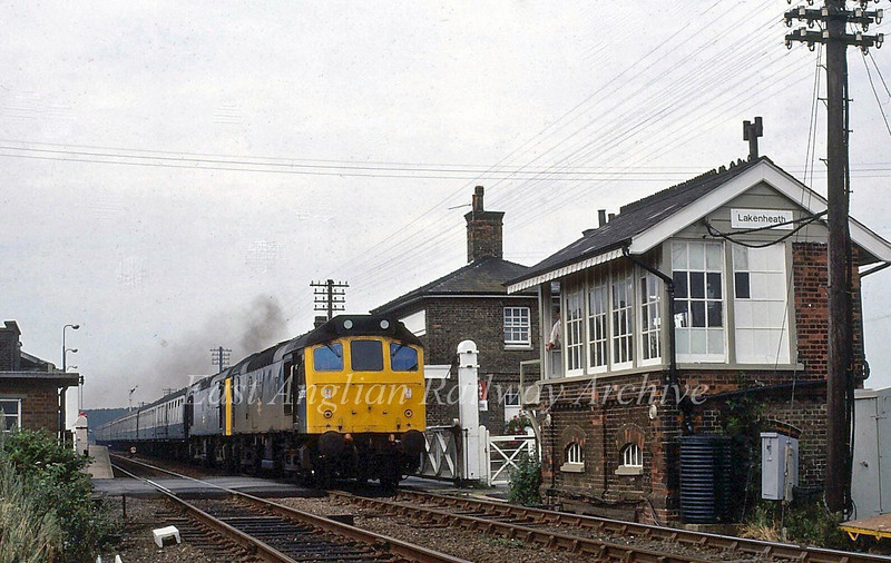 A pair of unknown class 25's head a Yarmouth Summer Saturdays only Yarmouth train at Lakenheath in the summer of 1981.