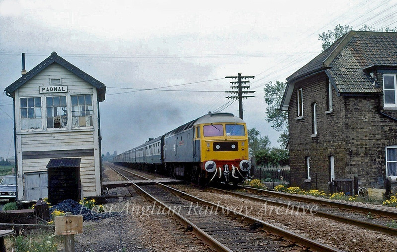 "47184, ""County of Cambridgeshire"", speeds past Padnal signal box with the summer Saturdays only Newcastle to Yarmouth. 24th May 1980"