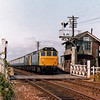 The 0832 Summer Saturdays only Derby to Yarmouth passes Shippea Hill behind 25032 and 25023 on 21st July 1979. The signal box appears to have a slight list and is supported by wooden beams on the shrinking fenland soil. In August 2012 the signal box closed and the crossing gates replaced by automatic barriers.