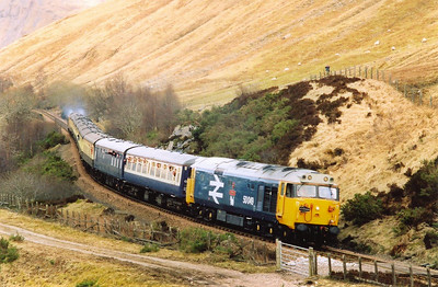 Having negociated the Horse Shoe Curve all climbing at a ruling gradient of 1 in 55, 50049 with 50031 working at the rear approach the County March. The sound of the English Electric 16CVST 2,700hp power plants roaring back of the hills was superb.
