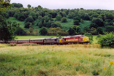 Out on the Kyle branch, the pair of type 3 locos come round the sharp curve at the site of Fodderty Junction, junction for the closed short branch to Strathpeffer, and the bottom of the climb to Raven Rock summit, 4 miles away.