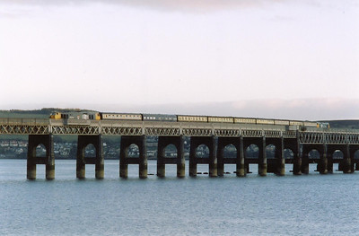 The train approaches the north bank of the Tay as the bridge curves round to the north east.