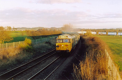 After a short time while the crew change ends, 1Z24 heads west for Perth and Glasgow now with 50031 leading into the evening sun which has now appeared!! Both locos were adorned with the Eastfield shed West Highland terrier motif.  6/3/05