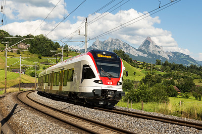 SBB 523 064  climbing between Steinen and Goldau  on 27 June 2016.   The peaks in the background are Kleiner Mythen and Grosser Mythen