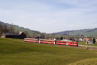 A three car unit headed by a BDe 4/4 power car decends into Appenzell from the Gosau direction.  22/03/11