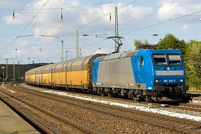 185 514-7 heads west through Rottendorf towards Wurzburg with a lengthy train of covered car carriers - 13/09/12