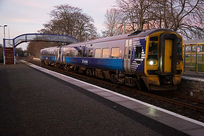 With the last of the usable light virtually gone as the sun had dropped below the hills to the west, 158717 slowly runs into Tain with 2H62 1234 off Wick to Thurso, reverse and back to Georgemas Junction, reverse again and head for Inverness.