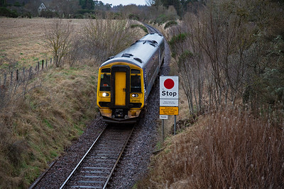 About 20 or so minutes after the previous photo and 158711 returns after its short station dwell at Tain, probably long enough to exchange radio tokens.  Now the set approaches the road over bridge at the station on a falling 1 in 100 gradient.