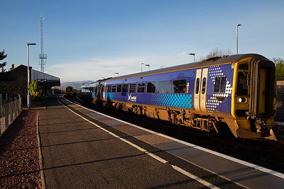 As 158718 clears the station, 158718 waits its time. The working is 2H63 1041 Inverness to Wick via Thurso.