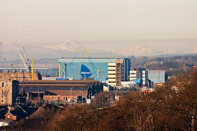 The ruins of Rosyth Castle is to the immediate left and is being swallowed up by the developing port all around it. Babcock's massive shed is prominent as the snow covered hills in the far distance.