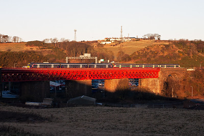 A pair of class 170 Turbostars in different liveries cross Jamestown Viaduct with an unknown working.
