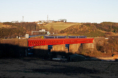 A pair of class 158 sprinter passes over the Viaduct. I can not identify the working.