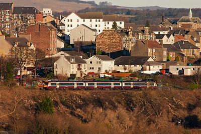 The embankment south of Inverkeithing tunnel has been cleared of trees and opens up the shot. A class 170 unit drops down the 1 in 70 gradient towards the station. The Carmine and Cream livery looks great when clean and lit well.