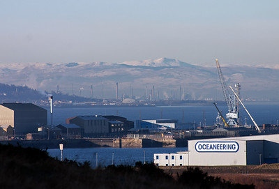Another part of Grangemouth Refinery is visible on the southern shores of the Forth and beyond that are hills but I'm not sure which.