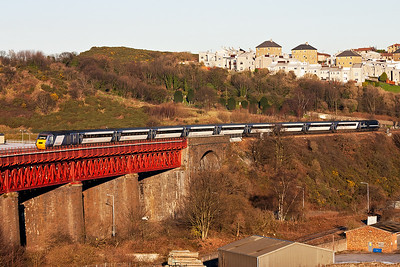 The 0710 from Leeds to Aberdeen, 1S11, comes off Jamestown Viaduct heading north. The trailing powercar is 43208.