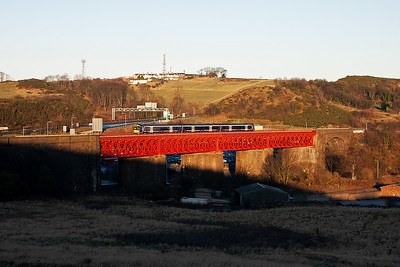 A single class 170 unit forms 1B14 0703 Dyce to Edinburgh train and pulls up the 1 in 70 gradient from Inverkeithing to level off at the Forth Bridge.