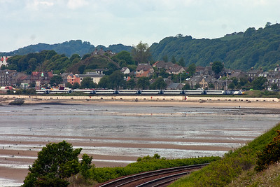 Moving to Pettycur Bay but looking back to Burntisland and the 0710 Leeds departure to Aberdeen, East Coast's 1S11, passes along the shore. Powercars are 43300 and 43306.