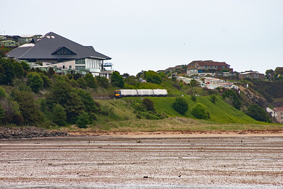 Turning round and the line is climbing hard at 1 in 128 and 170419 passes below the new clubhouse at Pettycur Bay caravan site. The next stop is Kinghorn a short distance away.