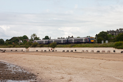 A service to Glenrothes is formed by 170419 in ScotRail livery passes by. The train is 2K67 1006 off Edinburgh.