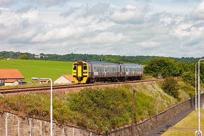 Alphaline liveried 158870 heads north with a class 2 all stations stopper from Edinburgh to Glenrothes with Thornton. The working is 2K69, 1105 from Edinburgh.
