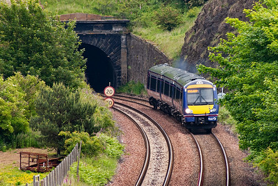 Turbostar 170431 exits the tunnel with 2G49, 0933 Newcraighall to Edinburgh via the Fife Circle. Despite its short length the tunnel has a kink in it as the contractor digging the tunnel missed the two working headings by the width of the bore. Hence the speed limit.
