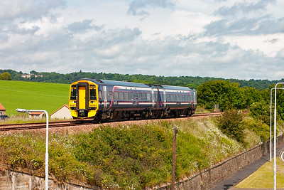 A move to Seafield, just at the edge of Kirkcaldy at the site of the former Seafield Colliery. It is now a housing estate and part of it provides a grand viewing platform for the railway southbound. 158733 is seen again working 1L12 1057 off Perth fo Edinburgh.