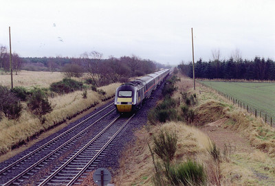 A down GNER high speed train passes the site of Lochmuir Summit loop with 1S20 1030 Kings Cross to Aberdeen. The loop was on the down side of the line with a signalbox at the south end.  12/3/1999