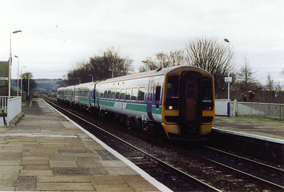 A non stopping working runs through platform 2 at the regulation 40mph speed limit for the turnout onto the Newburgh branch. 158725 and 158731 forms 1L37 1128 Edinburgh to Perth.  15/1/2000