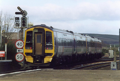 A pair of class 158 sprinters take the Newburgh branch with a Perth bound train, 158739 and 158704 form 1L37, 1128 off Edinburgh. On the signal post the lowest feather is for the down branch loop, now rarely used.  11/3/2000