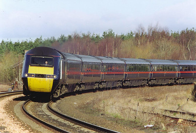 """43106 comes round the curve at Ladybank into the sun with 1E12 0955 off Aberdeen to Kings Cross, the up """"Northern Lights""""."""