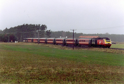A Virgin Cross Country working passes the level crossing at Bow of Fife a few miles from Ladybank. The train is 1V57 0910 Aberdeen to Plymouth.  28/2/2000