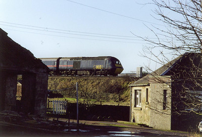 43116 is the rear powercar and is framed between a pair of buildings at the north end of Kingskettle.