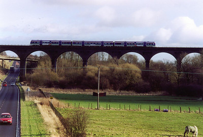 An unknown class 170 Turbostar crosses the North British Railway built Markinch Viaduct. The train is 1B24 1120 Aberdeen to Edinburgh.  10/2/2000