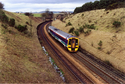 158735 comes up through the cutting at Kirkfortharfeus at the top of Falkland Road Bank with 1B22 1035 from Inverness to Edinburgh wich is routed via the Newburgh branch.  17/2/2000