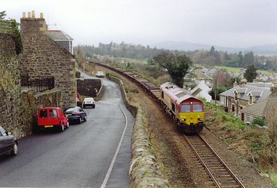 Two days later the empty pipe trains disturbs the peace of Newburgh with 66159 at the head. I made a comment to a local resident about the noise of the train, he said the loaded train is even noisier.