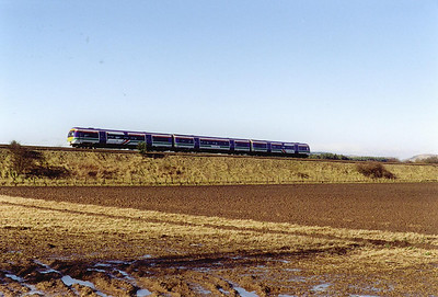 An unidentified ScotRail class 170 Turbostar runs between Ladybank and Kingskettle with 1B19 1008 from Dyce to Edinburgh.  19/2/2000