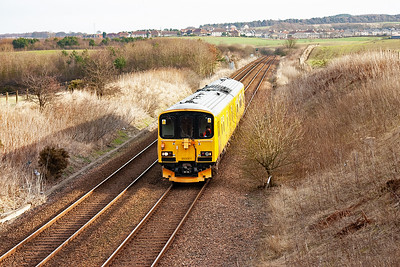 On the Fife Circle now and 950001 approaches the road over bridge on the Lisa Brae as it heads for Alloa via the Longannet branch. I leave it here and now head home. 1/2/10