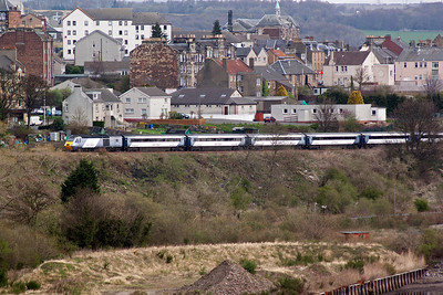 The first departure from Aberdeen for London Kings Cross is at 0752, 1E10, and this East Coast set climbs away from Inverkeithing. The lead powercar was not identified at the time.