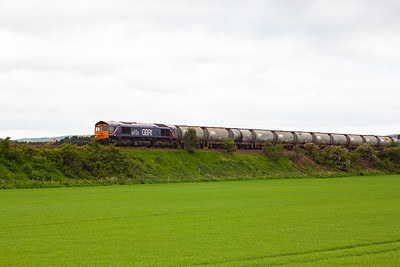 GBRf 66725 hauls 15 empty TUA mud oil tanks south as 6E59 0730 Aberdeen to Harwich. The empty train is routed through Fife and over the Tay Bridge. The outward run is via Stirling and Perth as the train is too heavy for the Tay Bridge. 10/6/10