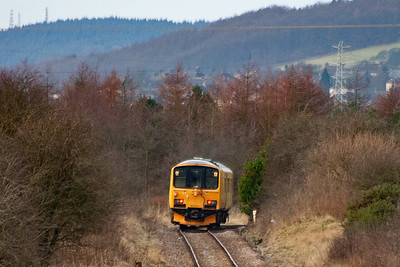 The unit takes the right hand curve and will go out of sight.  When built, this line joined with the main line to Kinross and Perth at Kelty via Lochore.