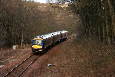 Scotrail turbostar 170431 passes through Collessie Den on the single line Newburgh branch with 1B08 0646 Inverness to Edinburgh. 1/2/10
