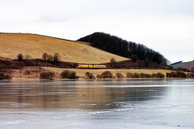 The first day of February 2010 was very cold and the preceding week or so was equally cold, so cold in fact that Lindores Loch was frozen over. Looking across the ice is Network Rail's class 150 sprinter test unit 950001 working 2Q08 0400 Craigentinny to Craigentinny via the Fife Circle, Dundee, Perth, Westfield, Alloa via the Longannet branch!! Here it is running late heading from Perth to Westfield.
