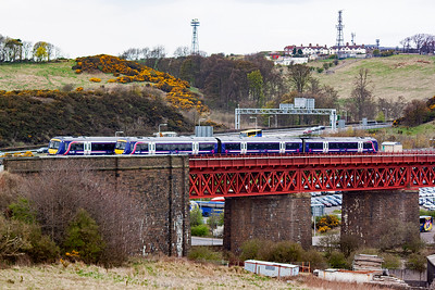 Two unidentified class 170 turbostars pass each other on Jamestown Viaduct. The left hand unit heading downgrade is working 2G49 0933 off Newcraighall to Edinburgh via the Fife Circle. The other sets working in unknown.
