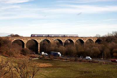 The three car unit passes over the 10 arch structure completed in 1847. The service is not booked to stop at Markinch station.