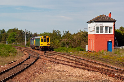 """The main reason for spending a sunny afternoon on Leuchars station passes the 'box. DRS 37423 propels Network Rail Observation Coach """"Caroline"""" with train 2Z02 0942 Inverness to Edinburgh via Aberdeen.  The signalman waves to the driver who waves back."""