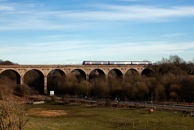 The view of Markinch Viaduct from the formation of the former Leslie branch at Markinch which is now a footpath. An unknown class 170 turbostar forms 1A78 1530 Edinburgh to Inverurie. 22/3/2011