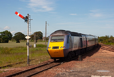 The HST set departs with 43318 on the rear passing the down starter.