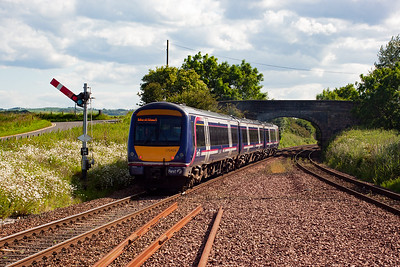 170424 powers away from Leuchars passing the up starter LE29. The former route to St Andrews and the Fife Coast line to Thornton branched left just beyond the bridge. Trains terminated here in a bay in the centre of the island platform.