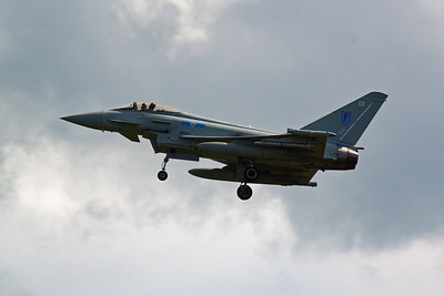A second Typhoon airframe, ZK307 EE, passes over the station on short finals to land.
