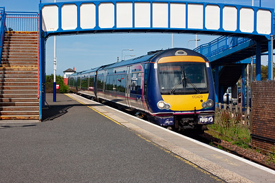 Moving to Leuchars station proper and 170429 runs in to stop at the former junction station with 1B35 1407 Aberdeen to Edinburgh service.